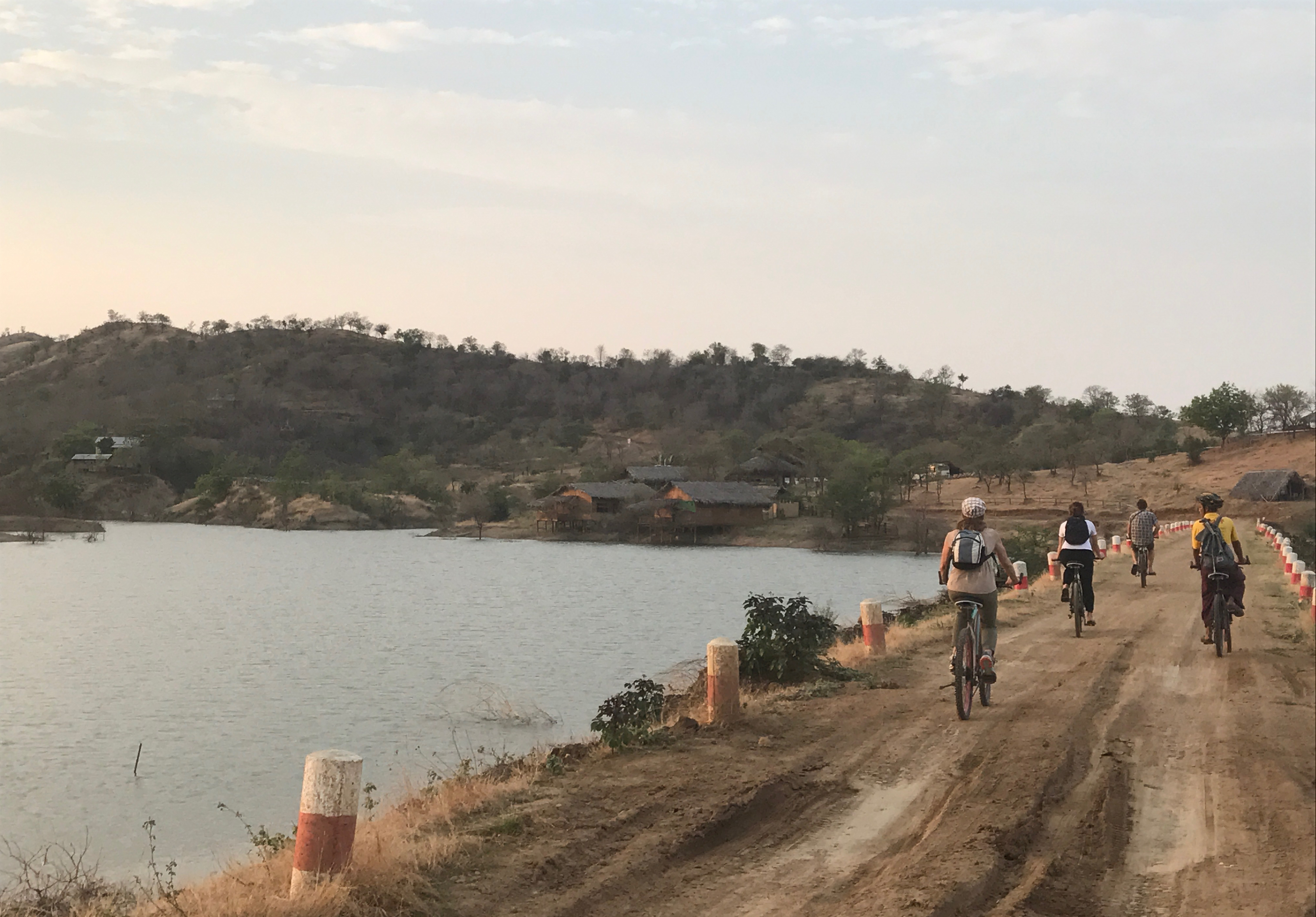 Visitors to Myaing cycle back to the community lodge from a local village closeby